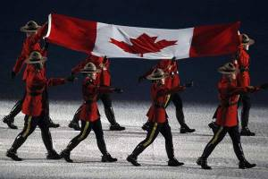 The RCMP carrying the flag